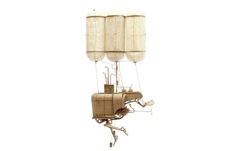 Artist Daniel Agdag crafts fantastical miniature flying machines from cardboard.
