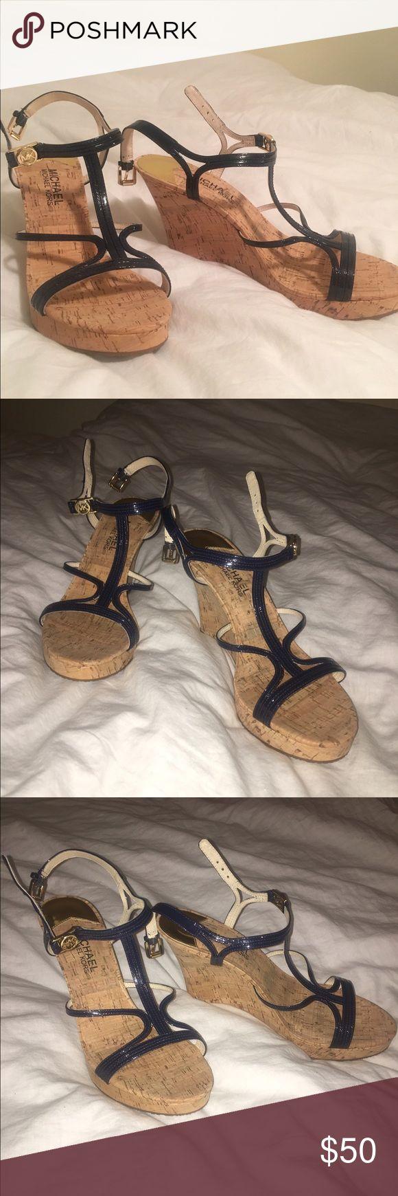 Michael Kors Navy Wedges Never been worn Michael Kors navy wedges! Michael Kors Shoes Wedges