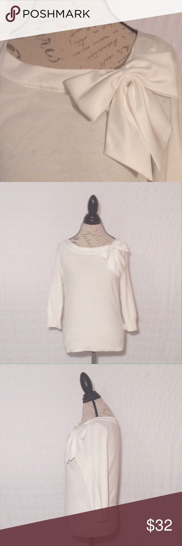 WHBM Cream colored Bow front top 3/4 sleeves Beautiful top in great condition minimal piling if any and no flaws or stains.  Measurements and fabric content are in photos.  Smoke and pet free home.  Ships same or next day!! White House Black Market Tops