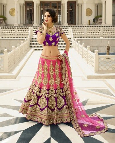 1. Purple and pink silk lehenga 2. Dupion silk Blouse and lehenga embellished with golden zari work highlighted with pearl and rhinestones 3. pink Net dupatta with embroidery and scalloping embroidered border 4. Can be stitched up to size 42