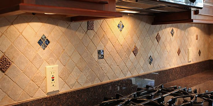 mosaic tile pattern for back splash in breakfast room; grey tiles with accents of metallic blue tiles