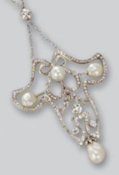 Pearl and diamond necklace, circa 1900. The openwork pendant decorated with circular- and rose-cut diamond bows and garlands, set at the principal points with four natural pearls, mounted in silver and gold, on a chain of fancy linking set with circular-cut diamond seed pearl spacers.