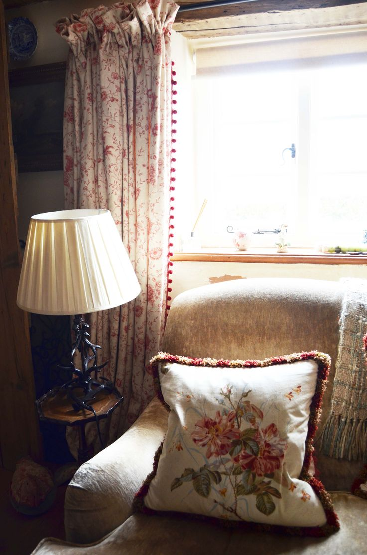 Red and cream living room chair, curtains. www.suescammellinteriors.co.uk
