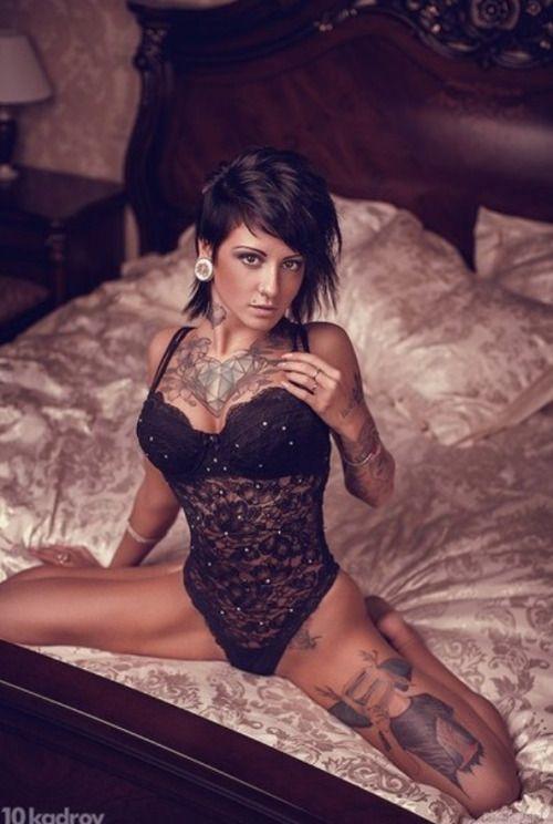 Perfect tattoo body of hot brunette girl in black lingerie