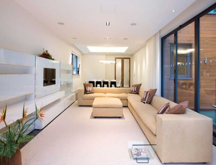 Decorating Ideas for Long Living Rooms with white wooden wall unit shelves with leather couches and leather couch
