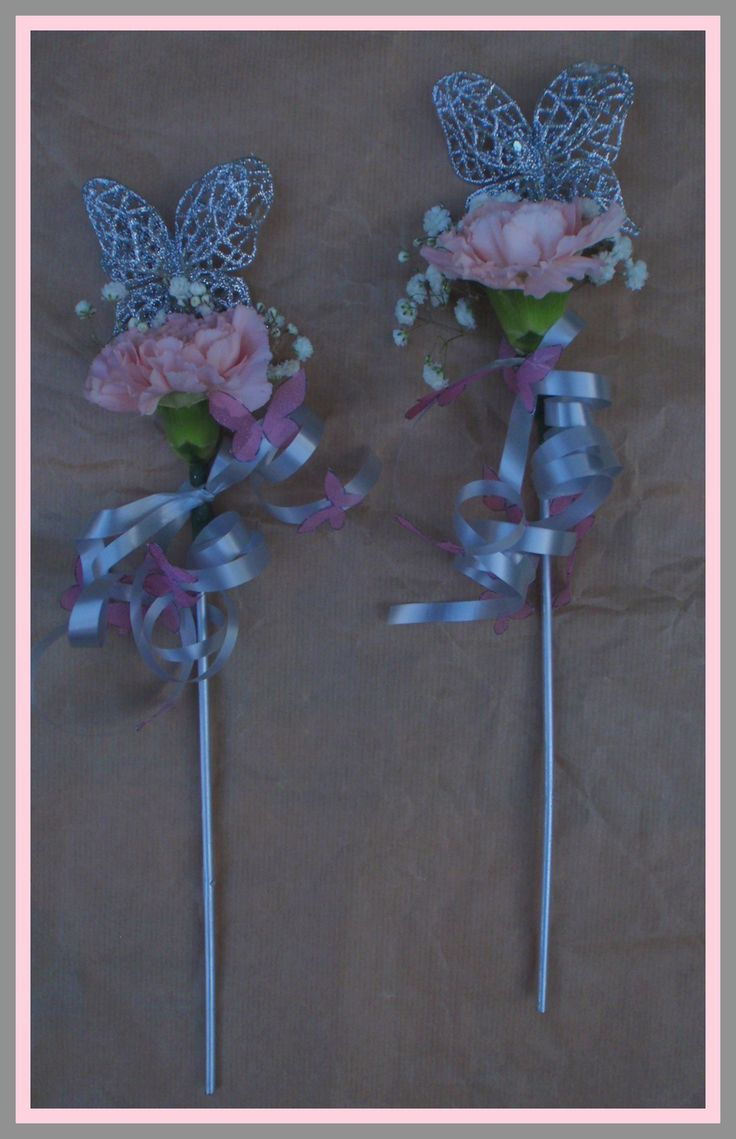 Silver butterfly wands for little bridesmaids with pale pink carnations