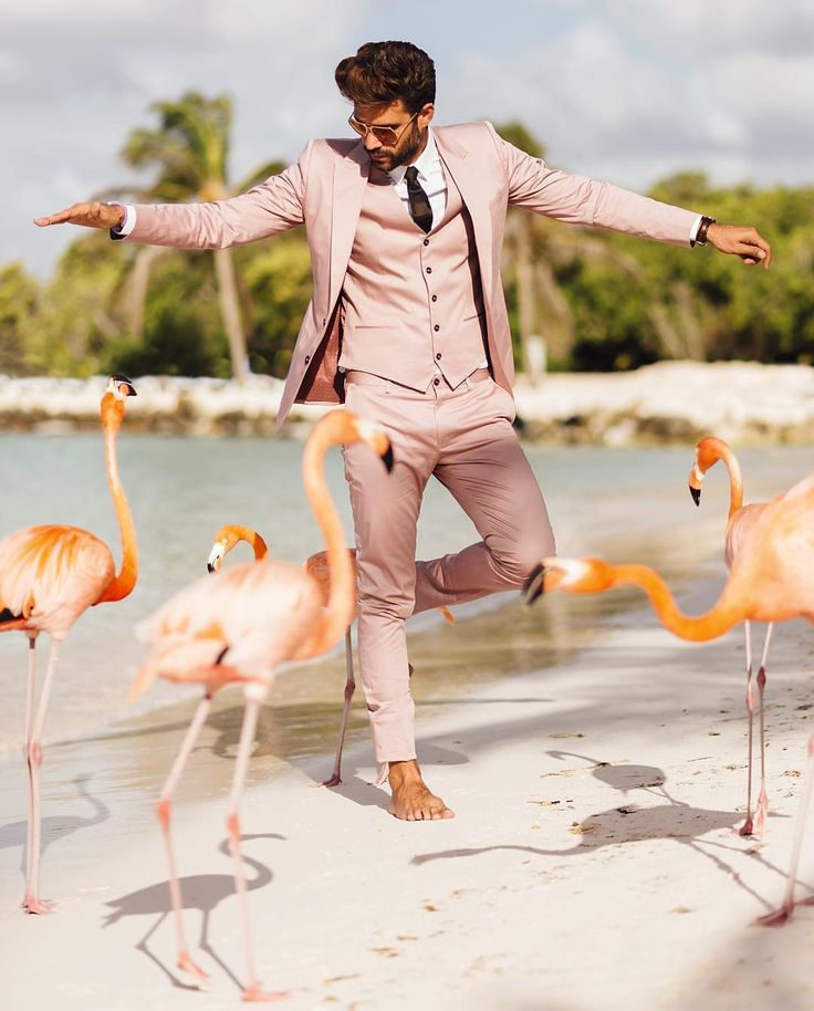 Flamingo and pink suit at the beach