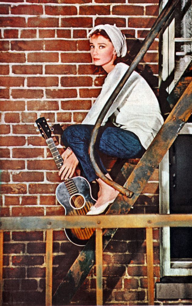 "This picture of Audrey Hepburn is from a scene in ""Breakfast at Tiffany's"". Totally diggin' Audrey and her guitar!"