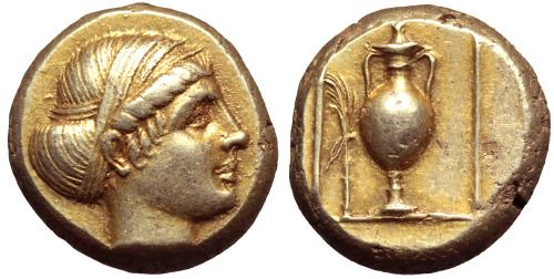 Electrum Hekte from Mytilene, Lesbos, c. 375-326 BC This is the finest of only 4 known examples of this coin. It shows a female head facing right, her hair bound up with ribbons and on the reverse is a Panathenaic amphora with a pointed lid, a...