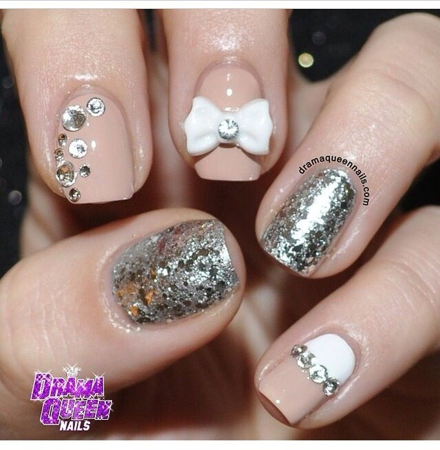 Nude and silver sparkle nail design with white bow