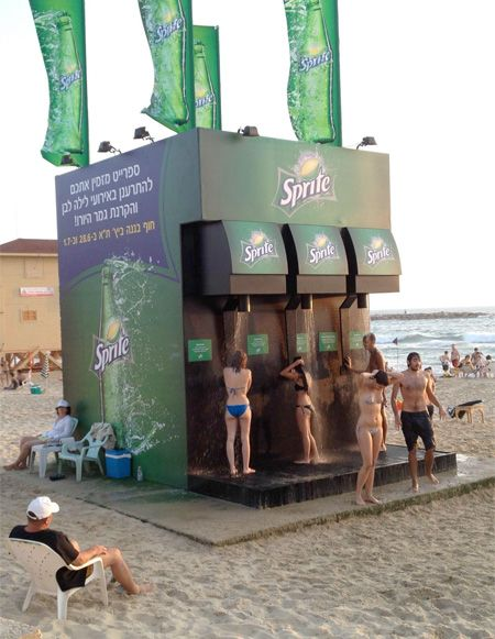Designed to look like a giant Sprite soda dispenser, setup on popular beaches in Brazil and Israel. Haha that's funny