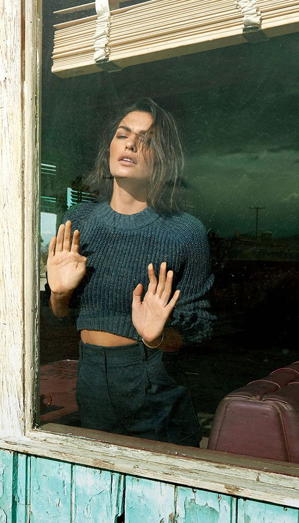 Alyssa Miller, wearing a cropped sweater and blue shorts, photographed by Yu Tsai for Vogue Mexico May 2014.