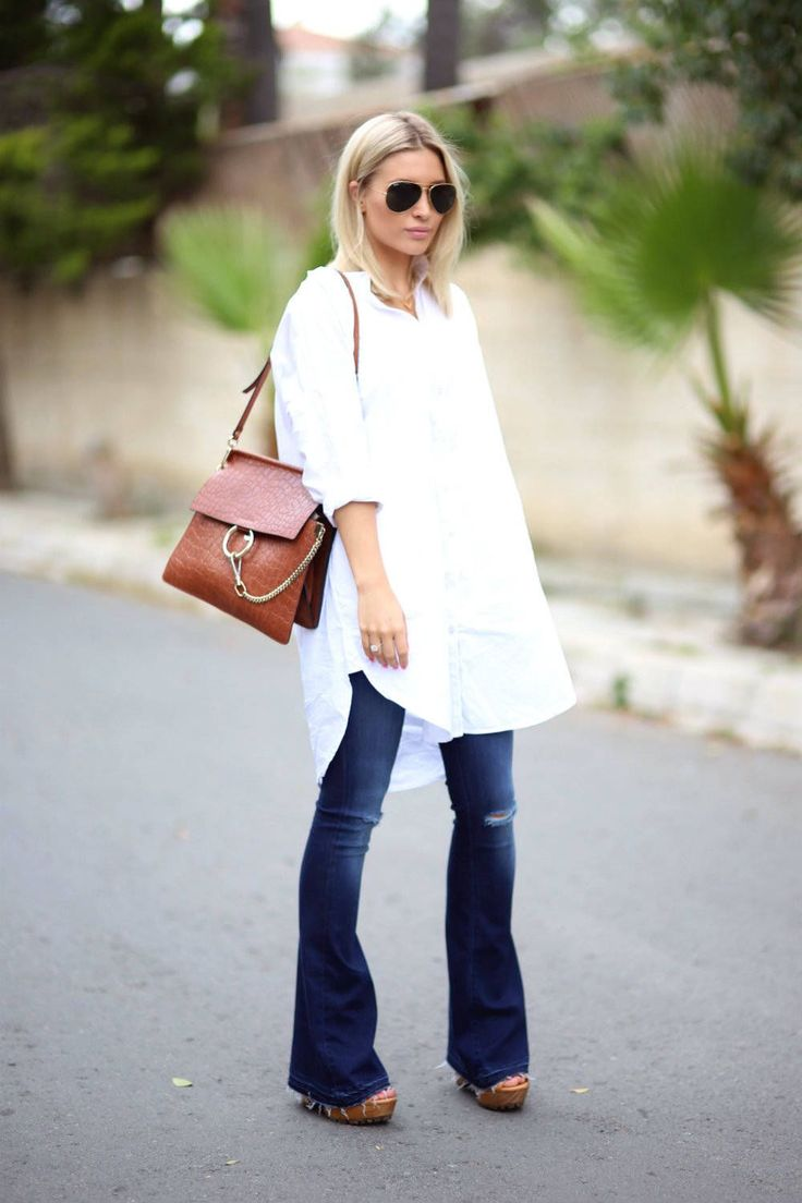 Flared jeans, a white shirt dress, and a leather purse