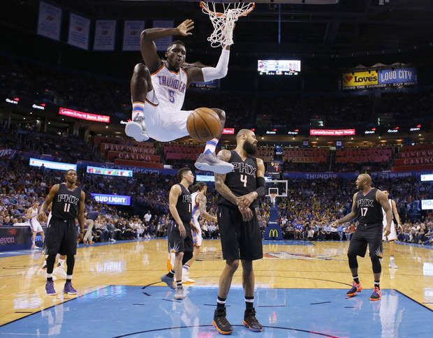 Oklahoma City's Victor Oladipo (5) dunks the ball in front of Phoenix's Tyson Chandler (4) during an NBA basketball game between the Oklahoma City Thunder and the Phoenix Suns at Chesapeake Energy Arena in Oklahoma City, Friday, Oct. 28, 2016. Photo by Bryan Terry, The Oklahoman