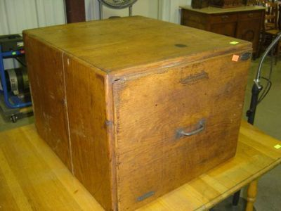 oak single drawer file cabinet with brass tag prop