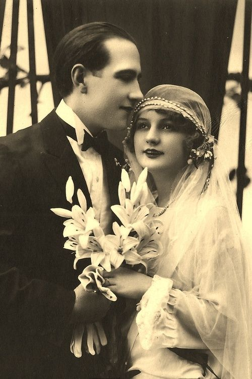 this picture is from the 1920s an shows a newlywed couple. wedding dresses looked different in the 1920s then they do today. the couple looks happy.in the 1920s people started to marry for love. before then, people got married for money.                                                                                                                                                                                 Más