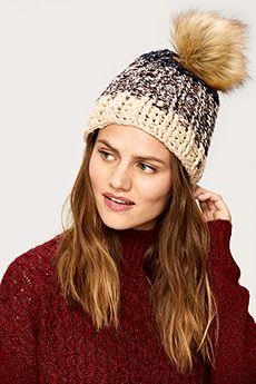Shop Lolë's SPARKLE BEANIE that comes with interchangeable pom poms! #Beanies #WinterAccessories #Hats #LoleWomen