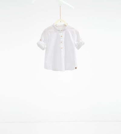 Image 1 of Shirt with Mandarin collar and roll-up sleeves from Zara