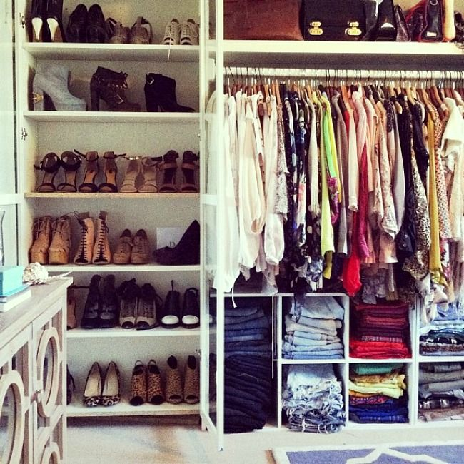 Great closet idea - utilize empty space below by putting shelves under clothing.