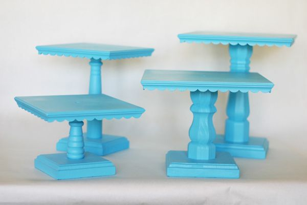 cake stands from plywood, furniture legs, and dollhouse trim from Michaels - very clever, plus they unscrew for storage