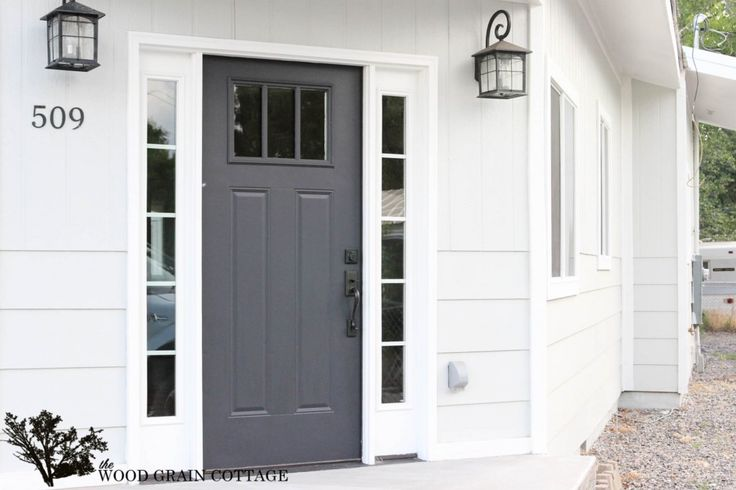 Main House Color: Gray Owl by Benjamin Moore in Satin Trim Color: Super White by Benjamin Moore in Semi- Gloss Front Door Color: Onyx by Benjamin Moore in Semi-Gloss