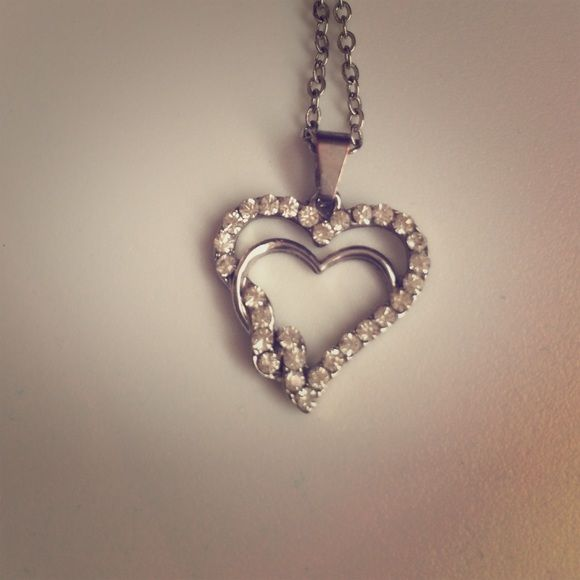 Silver heart necklace with diamond accents Silver heart necklace with diamond accents and silver chain. Jewelry Necklaces