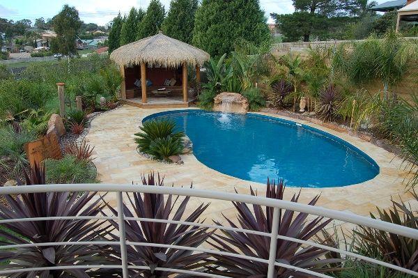 Rockery Pool Water Feature on a kidney Albatross pool set in a tropical garden oasis.