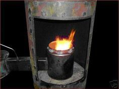Waste oil burner installed in discarded hot water heater