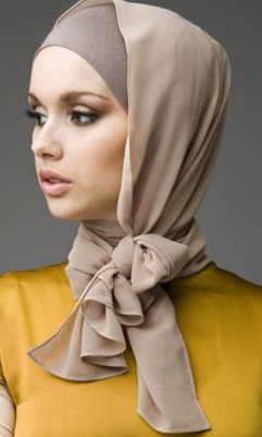 Cute hijab style. I'd wear the flap pinned down so that my neck is fully covered.