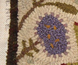 Use beading to hook the tiny petals on this purple flower!