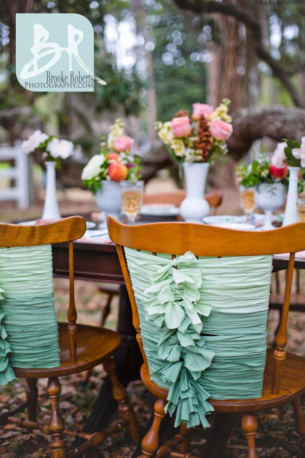 Weddings-jekyll-island-photographers-ombre-wedding-reception-chairs-diy-torn-fabric-ripped-strips-material-green-mint-peach-outside-reception-backyard-party-white-milk-glass-styled-southern