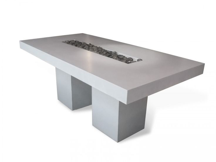 The VULCANI concrete dining table is composed of two layers of Beton Lege® and two stainless steel cylindrical legs. by matali crasset