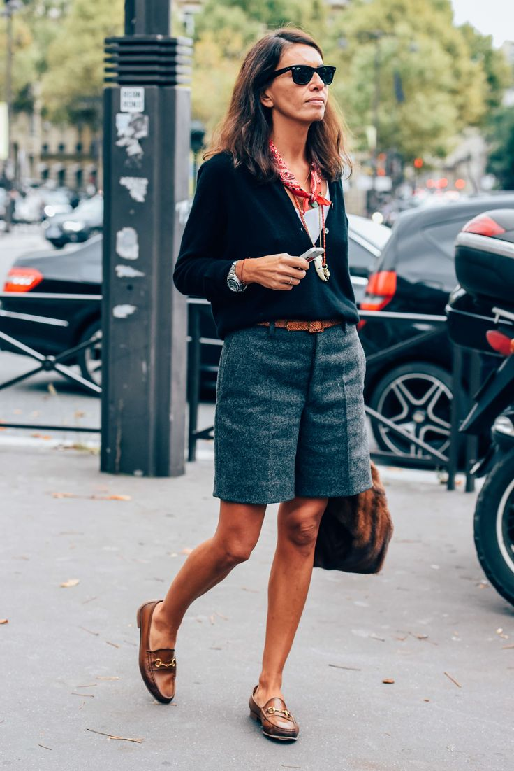 Wide shorts. Loose shirt tucked into shorts. Loafers. Scarf. Watch.