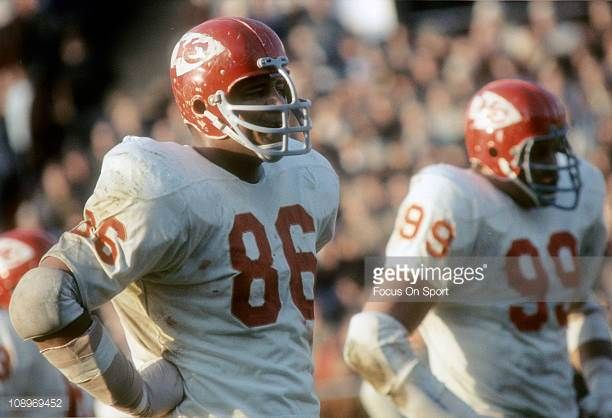 Buck Buchanan and Ernie Ladd of the Kansas City Chiefs looks on waiting for the offense to come to the line of scrimmage during an NFL football game...