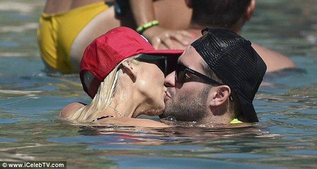 Passionate: Jonny Mitchell, 26, put on an amorous display with the US star, 31, as they shared a passionate smooch in the sea while soaking up the sun in Croatia on Monday
