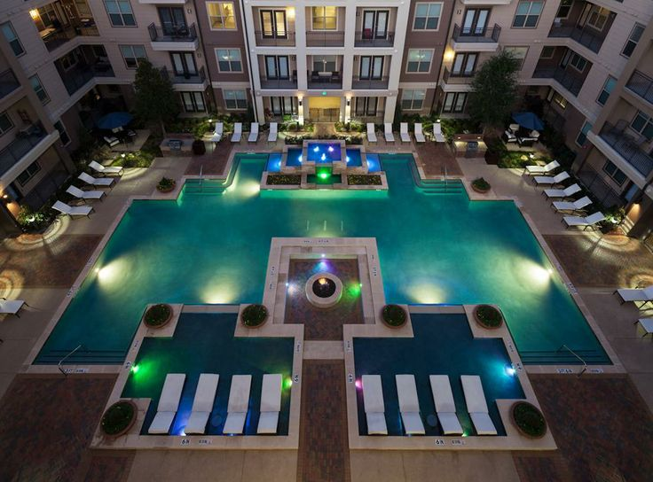 Resort Style Swimming Pool With Tanning Island And Elaborate Water Features  At AMLI On Maple