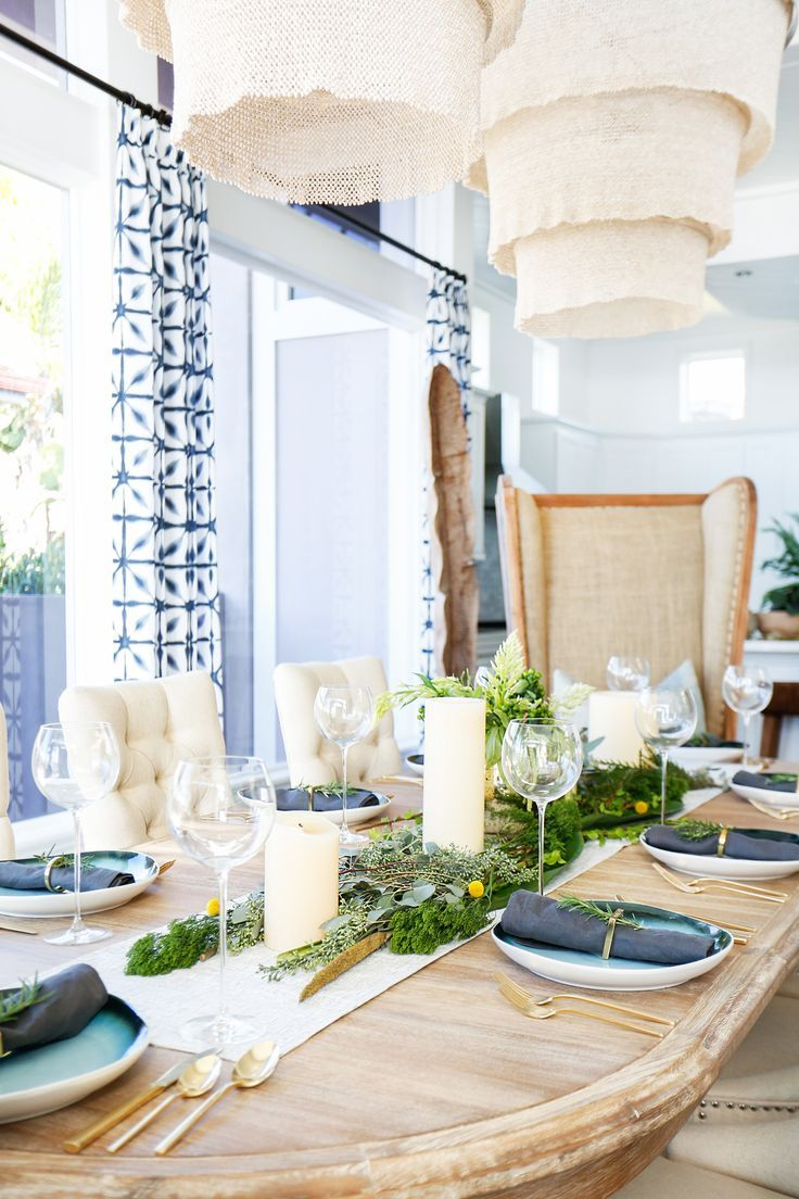 San Clemente Reveal | Part Two - Blackband Design Dinner party styling- fresh greenery, West Elm gold rimmed plates, West Elm brass silverware. Table styling inspiration. Large double chandeliers
