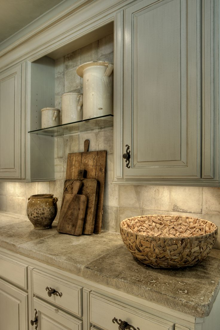 17th century French stone counters, gray cabinets
