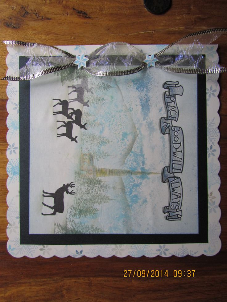 Christmas scene using Clarity banner stamps with stag and deer in front of the tall steeple church surrounded with pine trees