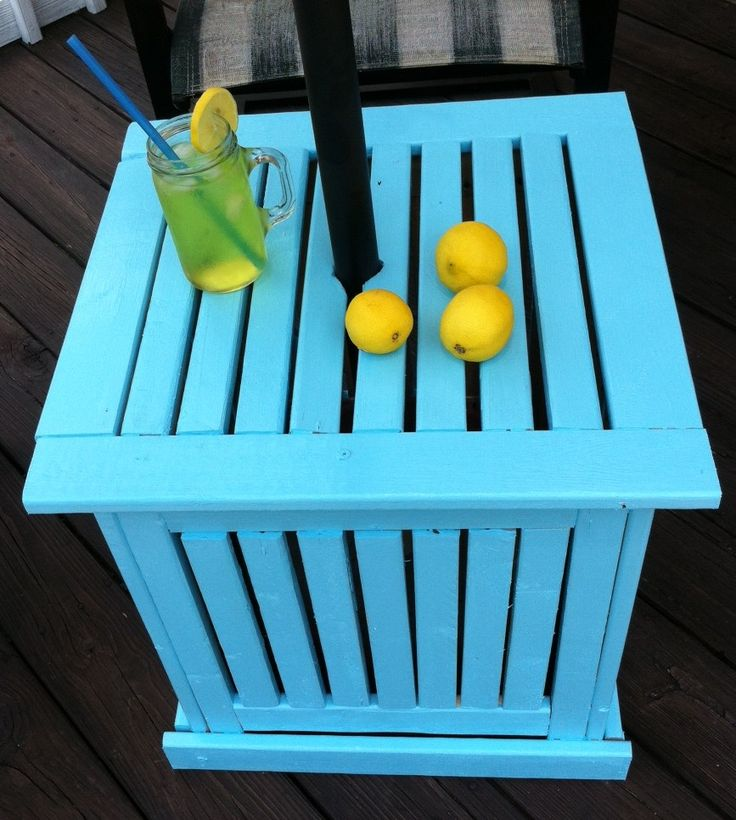 If you don't want to spend a lot of money on an umbrella stand/side table make your own.