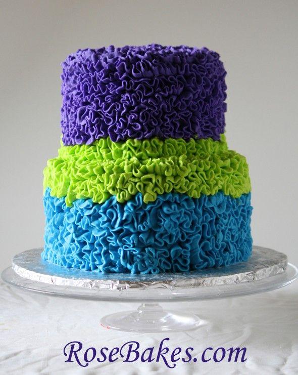 Google Image Result for http://rosebakes.com/wp-content/uploads/2012/04/Messy-Buttercream-Ruffles-Cake-Peacock-Colors-590x741.jpg