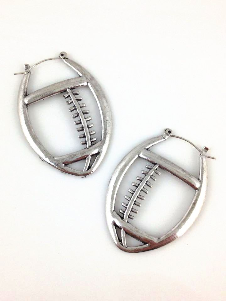 "Football Hoop Earrings in Silver. Gorgeous and unique pewter ""hoop"" earrings in the shape of a football. $20"