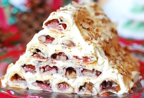 "торт Зимняя вишня -- ""Gorka"" is traditional Russian cake build as a pyramid of pasty tubes filled with Morello sour cherries – all covered in a sweetened sour cream filling."