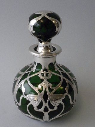 An Antique American Green Glass Sterling Silver Overlay Perfume Bottle of an Art Nouveau Design. $3,250