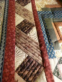 Great border idea. I wonder how it would look with jelly roll fabrics alternating lights and darks.