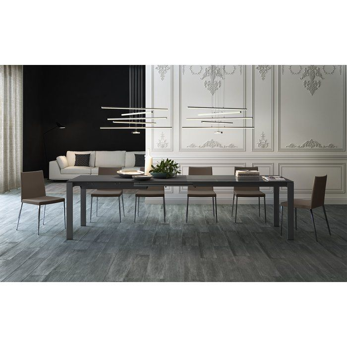 This classically styled Napoli Dining Table offers a timeless look and impressive expandability. Its glass top is under-painted to match its lacquered aluminum frame. Scalable for any occasion or room size - increasing its seating capacity from 6 to 10.