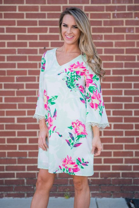 Local's Luau Dress, Green    This fun floral dress is absolutely precious! The mix of bright and soft colors is gorgeous! Plus, it has crochet around the sleeves and the cut outs in the back! This dress is going to be a tough act to follow!