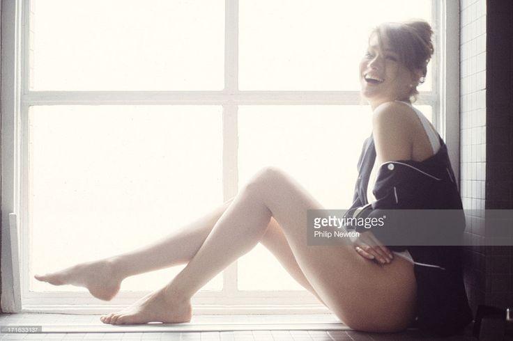 News Photo : Model/singer Carla Bruni poses at a fashion shoot...