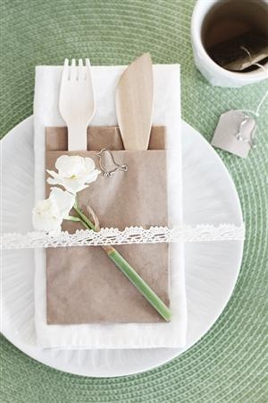 Table setting: Easter lunch  paper plates and toss away utinsels... love it!
