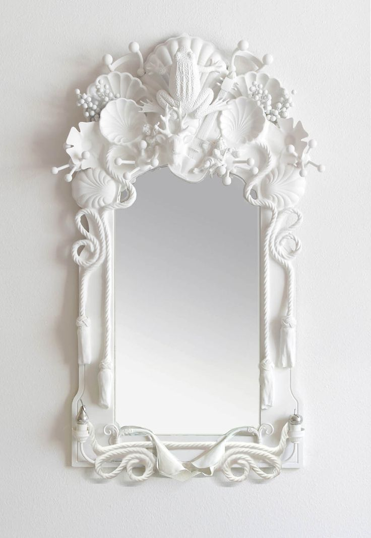 Codor Design mirrors. Layer found items then coat with plaster or white paint.
